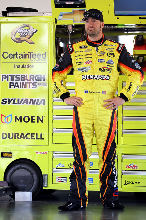 . DAYTONA BEACH, FL - FEBRUARY 20:  Paul Menard, driver of the #27 Menard\'s/Peak Chevrolet, stands in the garage during practice for the NASCAR Sprint Cup Series Daytona 500 at Daytona International Speedway on February 20, 2013 in Daytona Beach, Florida.  (Photo by Todd Warshaw/Getty Images)