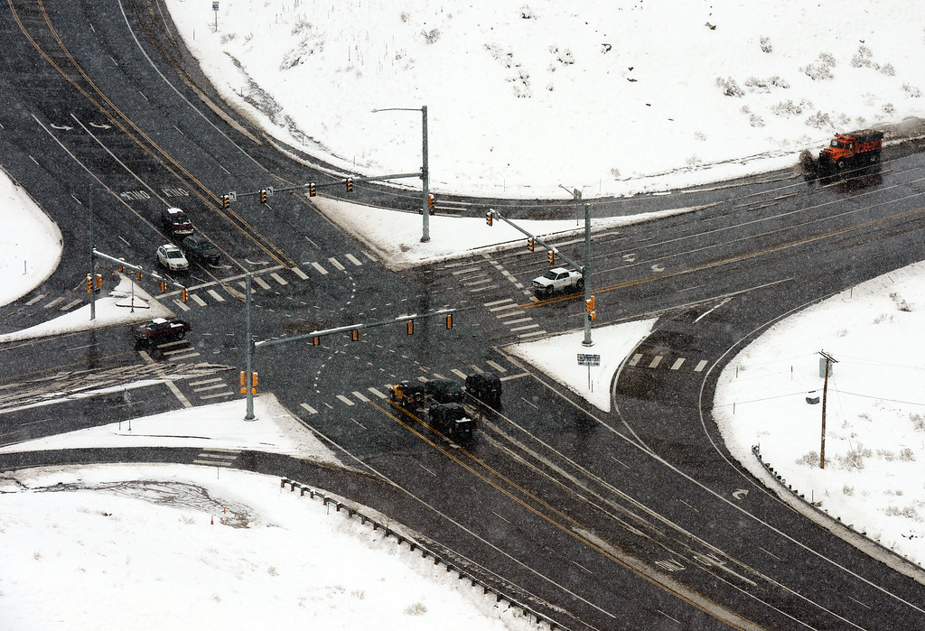 . GOLDEN, CO-April 23, 2013: A snowplow clears melting snow from the roadway at the intersection of Highway 93 and Highway 58 in Golden, April 23, 2013. (Photo By RJ Sangosti/The Denver Post)