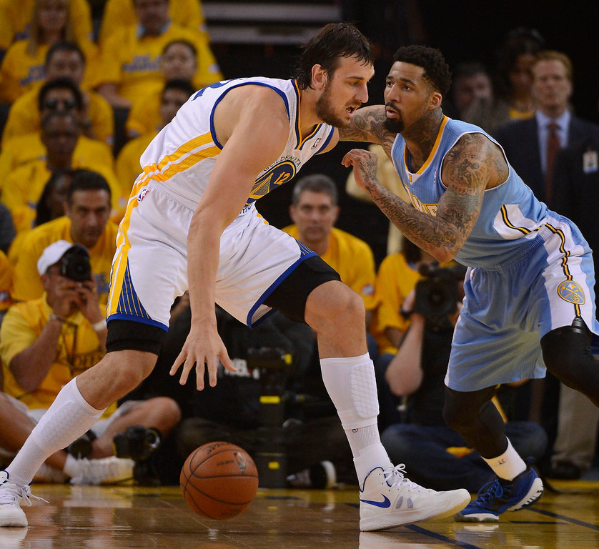 . OAKLAND, CA - APRIL 28:Andrew Bogut (12) of the Golden State Warriors is guarded closely by Wilson Chandler (21) of the Denver Nuggets during the first quarter in Game 3 of the first round NBA Playoffs April 28, 2013 at Oracle Arena. (Photo By John Leyba/The Denver Post)