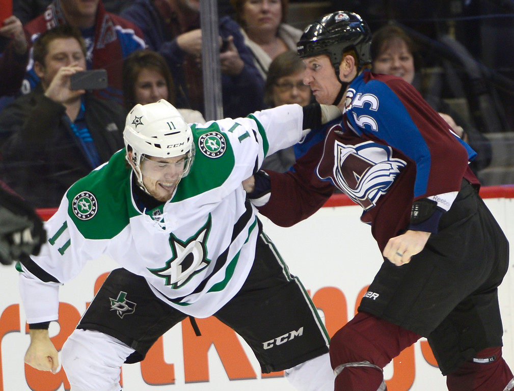 . Dallas Stars left wing Curtis McKenzie (11) flinches before being struck by Colorado Avalanche left wing Cody McLeod (55) during the first period Saturday, February 14, 2015 at the Pepsi Center in Denver, Colorado. (Photo By Brent Lewis/The Denver Post)