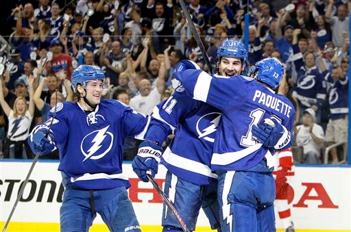 . Tampa Bay Lightning center Brian Boyle (11) celebrates with Cedric Paquette (13) and Victor Hedman (77) after Boyle\'s first-period goal against the Detroit Red Wings in Game 1 of an NHL hockey first-round playoff series, Thursday, April 16, 2015, in Tampa, Fla. (Dirk Shadd/Tampa Bay Times via AP)
