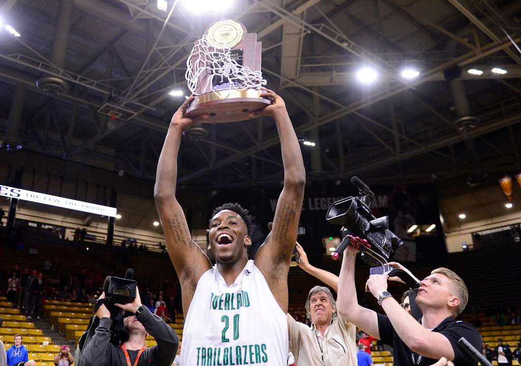 . De\'ron Davis (20) of Overland Trailblazers holds up the trophy after defeating Eaglecrest Raptors at the Coors Events Center on March 12, 2016 in Boulder, Colorado. Overland Trailblazers defeated Eaglecrest Raptors 66-56 to win the Colorado State 5A Basketball Championship.  (Photo by Brent Lewis/The Denver Post)