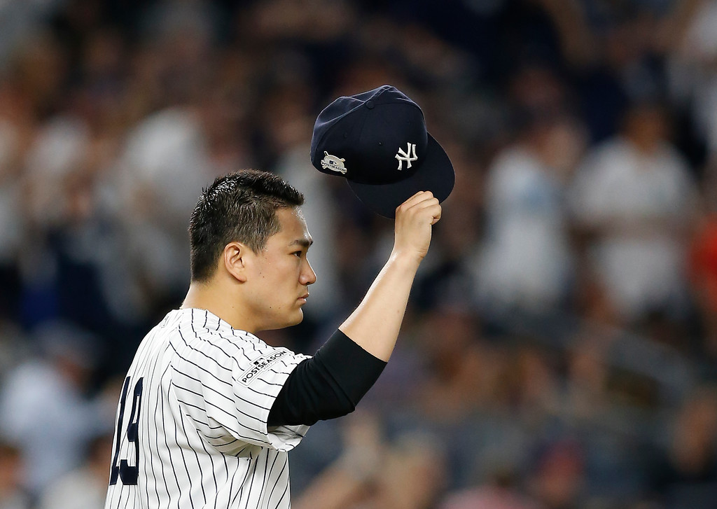. New York Yankees pitcher Masahiro Tanaka (19) tips his cap to right fielder Aaron Judge after Judge made a catch at the wall on a line drive hit by Cleveland Indians\' Francisco Lindor during the sixth inning in Game 3 of baseball\'s American League Division Series, Sunday, Oct. 8, 2017, in New York. (AP Photo/Kathy Willens)