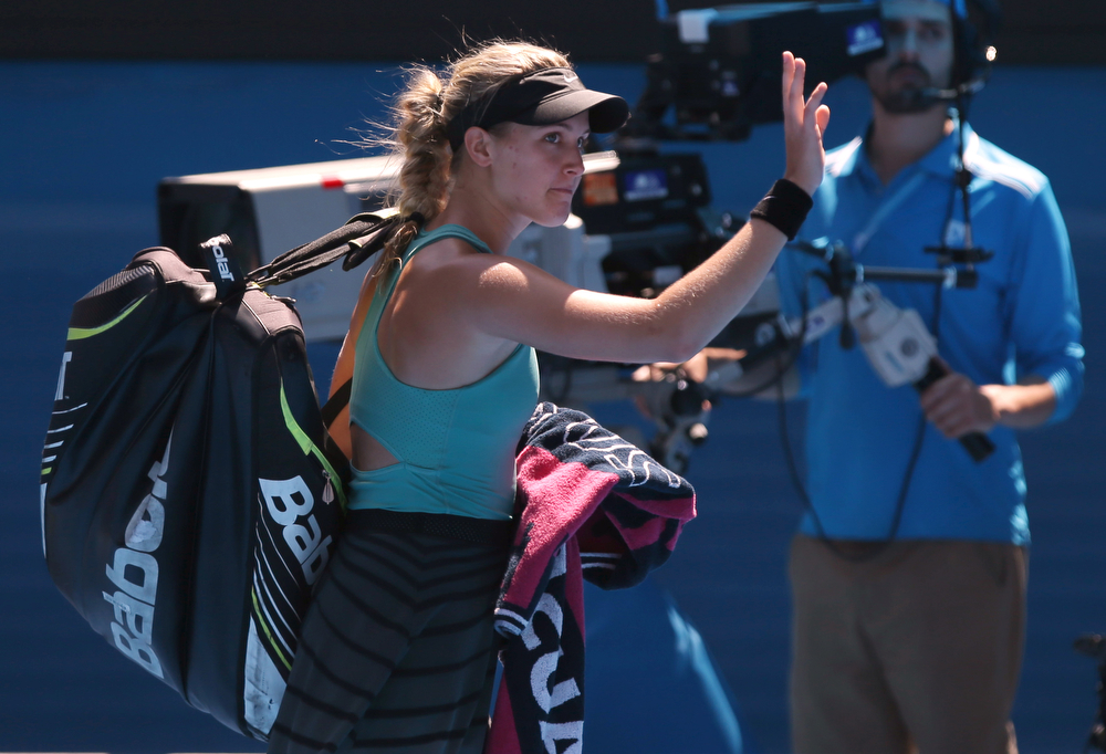 . Eugenie Bouchard of Canada walks off the Rod Laver Arena after her semifinal loss to Li Na of China during their semifinal at the Australian Open tennis championship in Melbourne, Australia, Thursday, Jan. 23, 2014.(AP Photo/Aaron Favila)