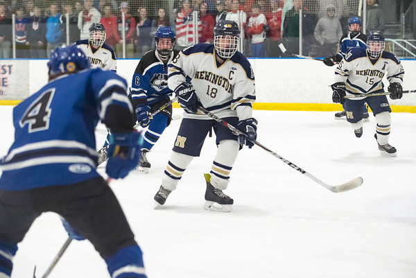02/26/20 Wesley Bunnell | StaffrrNewington Co-op hockey vs Hall-Southington on Wednesday night at Newington Arena. Newington captain Nick Deriu (18).