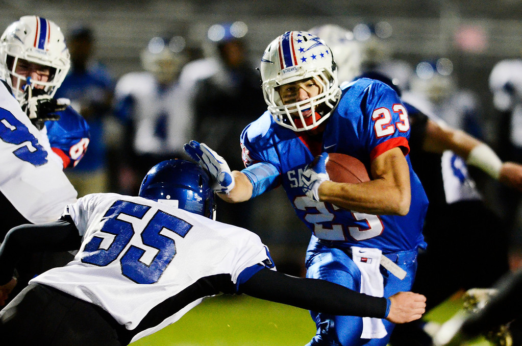 . Erica Miller - The Saratogian @togianphotog      Saratoga\'s Jordan Wilcox runs down the field during their playoff football game against LaSalle\'s Michael Whaley on Friday evening under the lights in Saratoga. SAR-l-SarFootball3