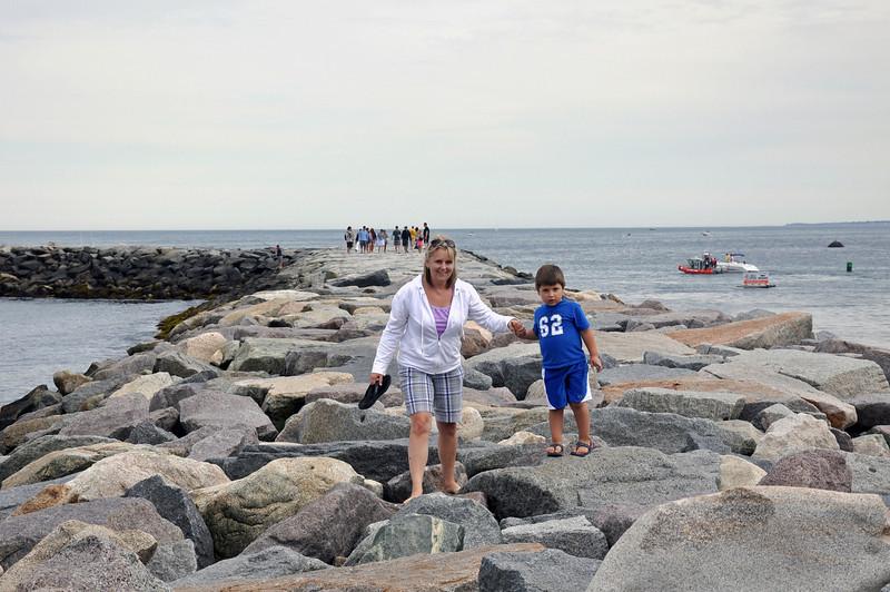 Scituate - Jonah helping Kim on the jetty.jpg