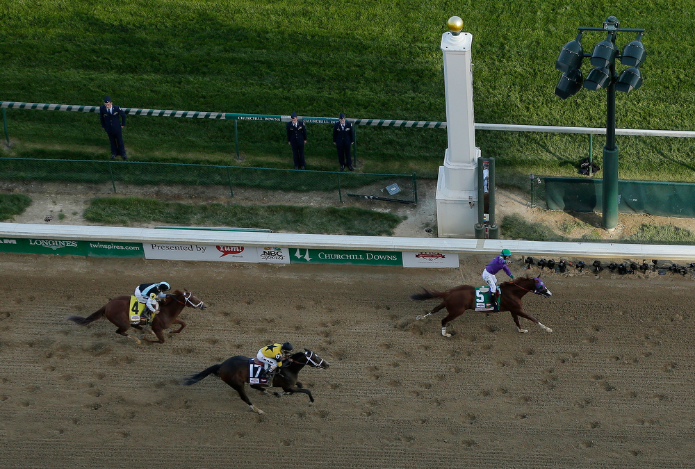 Description of . Victor Espinoza rides California Chrome to a victory during the 140th running of the Kentucky Derby horse race at Churchill Downs Saturday, May 3, 2014, in Louisville, Ky. (AP Photo/Charlie Riedel)