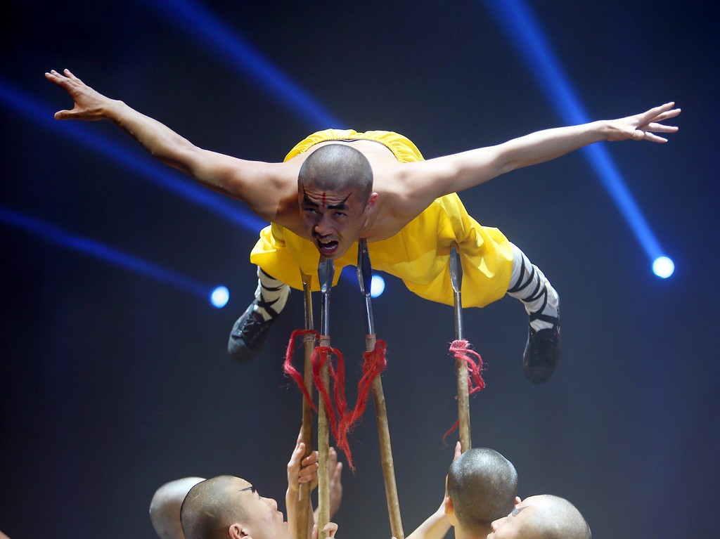 . A man is balanced on spears as the Shaolin Warriors perform during the UniverSoul Circus show under the big top on Hegenberger Road in Oakland, Calif., on Friday, April 5, 2013.  (Jane Tyska/Staff)