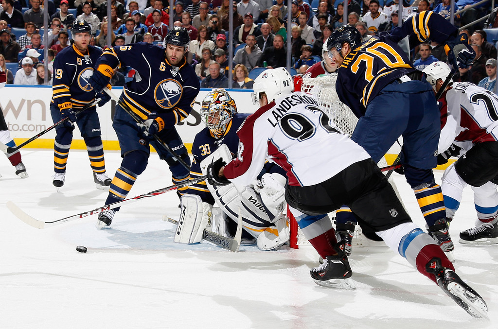 . BUFFALO, NY - OCTOBER 19: Ryan Miller #30, Mike Weber #6 and Henrik Tallinder #20 of the Buffalo Sabres and Gabriel Landeskog #92 of the Colorado Avalanche battle for the puck in front of the net at First Niagara Center on October 19, 2013 in Buffalo, New York.  (Photo by Jen Fuller/Getty Images)
