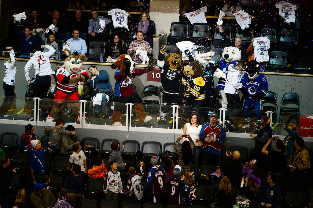 . Various mascots help Bernie, the Colorado Avalanche mascot, celebrate in a suite during the second period of action. The Colorado Avalanche take on the Nashville Predators at the Pepsi Center on February 18, 2013. (Photo By AAron Ontiveroz/The Denver Post)