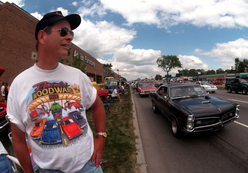 . Dale Buxton of Canton Ohio watches classic cars stream down Woodward Ave. in Royal Oak during the Fifth Annual Woodward Dream Cruise.