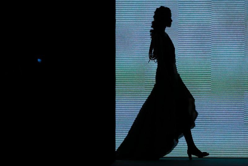 . A model wears a creation of Rebekka Ruetz\'s Autumn Winter 2014 collection during the Mercedes Benz Fashion Week in Berlin, Tuesday, Jan. 14, 2014. (AP Photo/Markus Schreiber)
