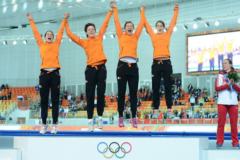 . Netherlands\' gold medalists Marrit Leenstra, Jorien ter Mors, Charlotte van Beek and Ireen Wust pose during the Women\'s Speed Skating Team Pursuit Medal Ceremony at the Adler Arena during the Sochi Winter Olympics on February 22, 2014. (JUNG YEON-JE/AFP/Getty Images)