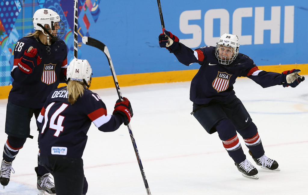 . Amanda Kessel (R) of USA celebrates after Brianna Decker (2nd L) of USA scored against Sweden during their semi final match between USA and Sweden at the Shayba Arena in the women\'s Ice Hockey tournament at the Sochi 2014 Olympic Games, Sochi, Russia, on Feb. 17, 2014.EPA/SRDJAN SUKI
