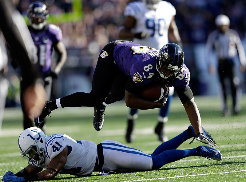 . Ed Dickson #84 of the Baltimore Ravens makes a reception against Antoine Bethea #41 of the Indianapolis Colts during the AFC Wild Card Playoff Game at M&T Bank Stadium on January 6, 2013 in Baltimore, Maryland.  (Photo by Rob Carr/Getty Images)