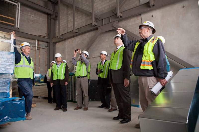 . Faculty tour the building on April 23, 2014 for a look at their labs, classrooms, offices and common spaces in progress. (Photo by Jason Willis/Oakland University)