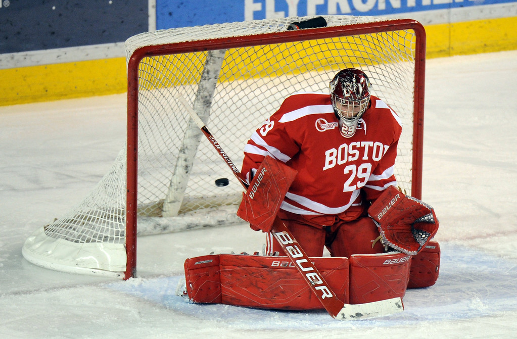. Boston University goalie Matt O\'Connor (29) is scored on  by University of Denver\'s Shawn Ostrow (26) in the 1st period of the game  at Magness Arena on in Denver on Saturday, Dec. 29, 2012. Hyoung Chang, The Denver Post
