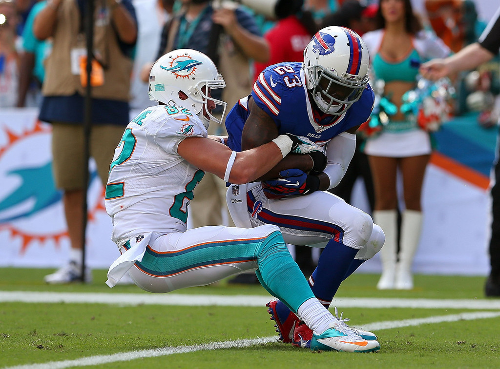 . Aaron Williams #23 of the Buffalo Bills makes an interception over Brian Hartline #82 of the Miami Dolphins  during a game  at Sun Life Stadium on October 20, 2013 in Miami Gardens, Florida.  (Photo by Mike Ehrmann/Getty Images)