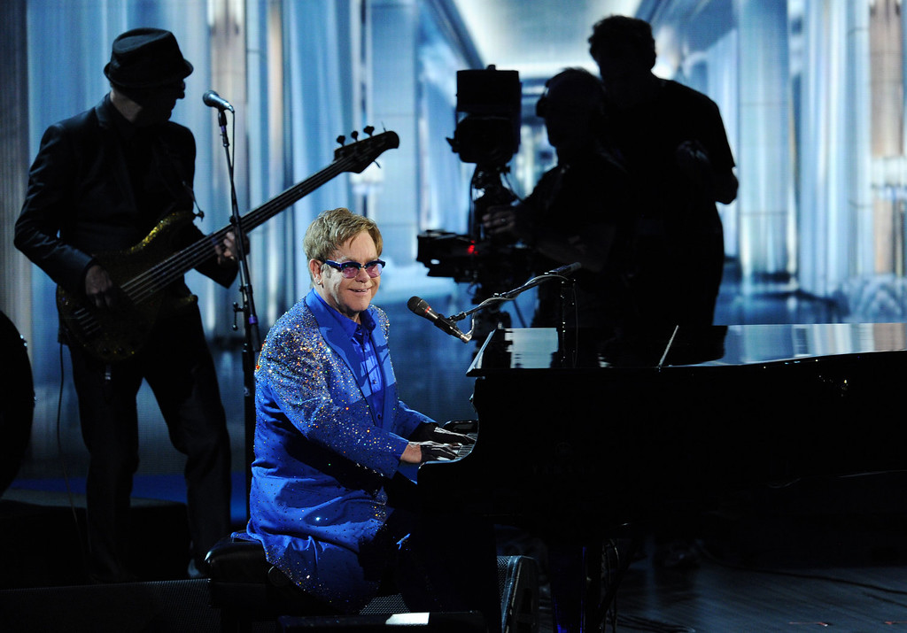 . Recording artist Elton John performs onstage during the 65th Annual Primetime Emmy Awards held at Nokia Theatre L.A. Live on September 22, 2013 in Los Angeles, California.  (Photo by Kevin Winter/Getty Images)