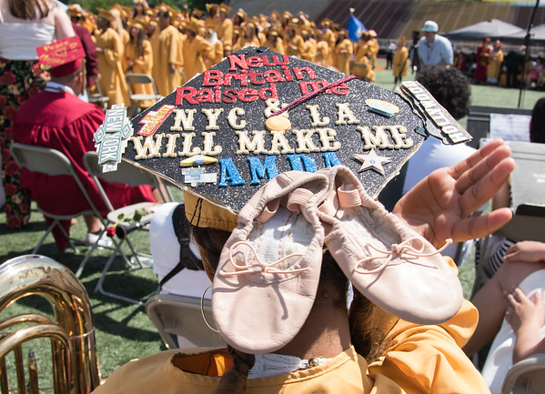 06/19/18 Wesley Bunnell | Staff Jessena Kellier's decorated cap showing her choice of studying dance at AMDA in New York City and Los Angeles during New Britain High School's graduation exercises at Veterans' Memorial Stadium at Willow Brook Park on Tuesday morning.