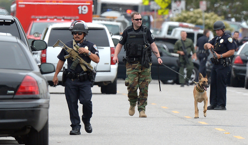 . Police search the grounds of Santa Monica College after multiple shootings were reported on the campus June 7, 2013 in Santa Monica, California.  At least six people died in the shooting rampage before police shot and killed a black-clad gunman in the college library, police said.  (JOE KLAMAR/AFP/Getty Images)