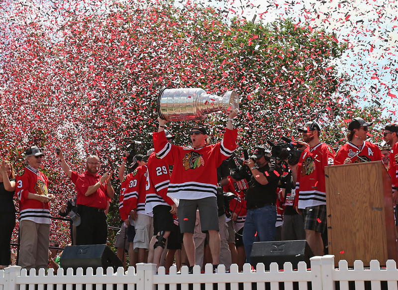 . Patrick Kane #88 of the Chicago Blackhawks holds the Stanley Cup Trophy during the Blackhawks Victory Parade and Rally on June 28, 2013 in Chicago, Illinois.  (Photo by Jonathan Daniel/Getty Images)
