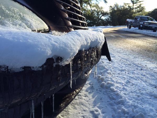. Icicles hang from the bumper of a vehicle on Wednesday, Dec. 31, 2014, which was stranded overnight on Highway 138 to Crestline. (Photo by Sarah Alvarado/The Sun)