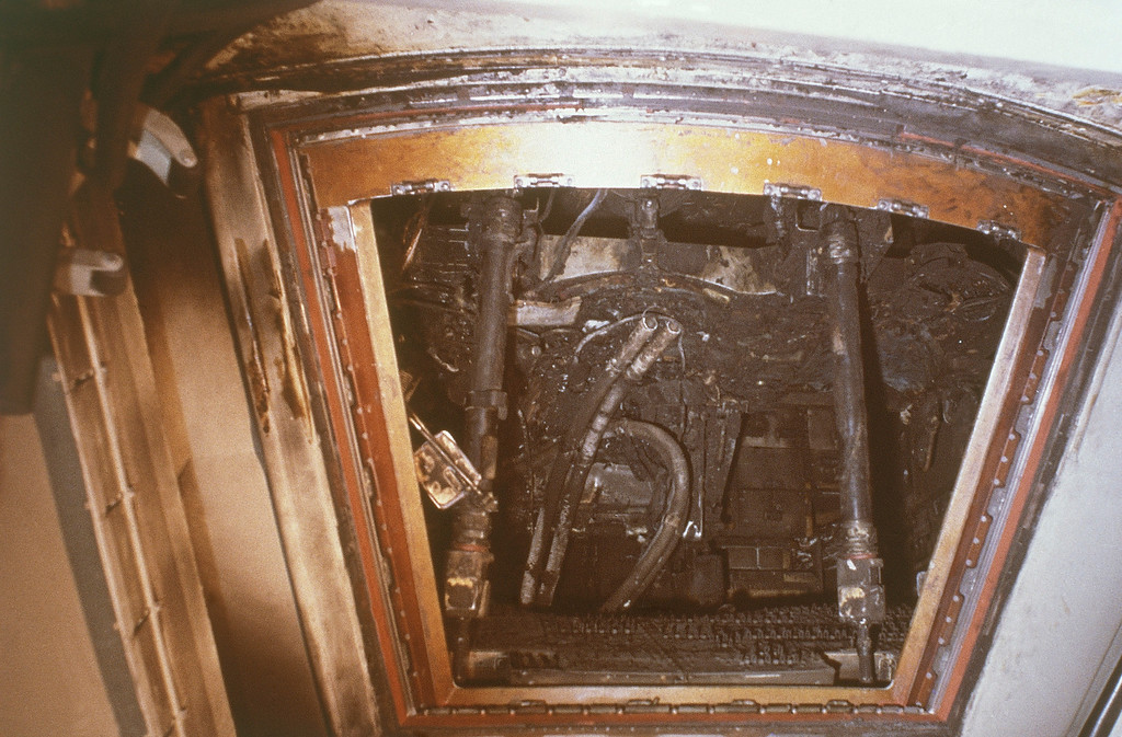 . The charred interior of the Apollo 1 spacecraft  after the flash fire that killed astronauts Ed White, Roger Chaffee, and Virgil Grissom, on January 27, 1967 at Cape Canaveral, Fla.    Photographed on Jan.28,1967 this severely damaged area is the most likely region for the start of the blaze.  The area is near the floor in the lower forward section of the left hand equipment bay below the spacecraft\'s Environmental Control Unit.    The National Aeronautics and Space Administration released a report in Washington about this incident on April 9, 1967.       (AP Photo).