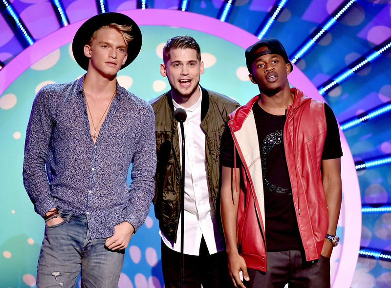 . (L-R) Recording artists Cody Simpson, Tony Oller, and Malcolm David Kelley onstage during FOX\'s 2014 Teen Choice Awards at The Shrine Auditorium on August 10, 2014 in Los Angeles, California.  (Photo by Kevin Winter/Getty Images)