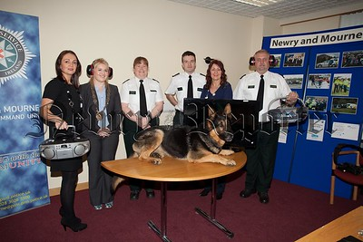 Pictured at Ardmore PSNI Station during Noise Action Week are, Mrs Sinead Trainor (Senior Environmental Health Officer), Cllr Naomi Bailie, Cons Alan McCartney (PSNI), Const Jack Gray (PSNI), Mrs Paddy Rooney-White (Assistant Housing Manager NIHE), Cons Alan MacCartney (PSNI) and Jack the Dof (PSNI). R1521001