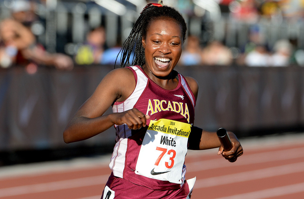 . Arcadia\'s Kyra White is all smiles as Arcadia wins the 4x200 meter relay seeded during the Arcadia Invitational track and field meet at Arcadia High School in Arcadia, Calif., on Friday, April 11, 2014.  (Keith Birmingham Pasadena Star-News)