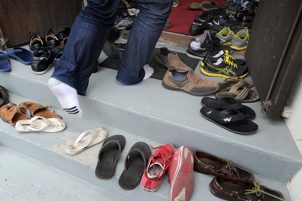 . Muslims leave shoes in the doorway before entering to pray and listen to the Imam Sayed Rashed who gaved a sermon Friday afternoon at the Islamic Center of Glendale. Services focused on the Islamic holy month of Ramadan, a period of inner reflection and devotion to God which starts Monday night. Glendale, CA. 7/5/2013(John McCoy/LA Daily News)