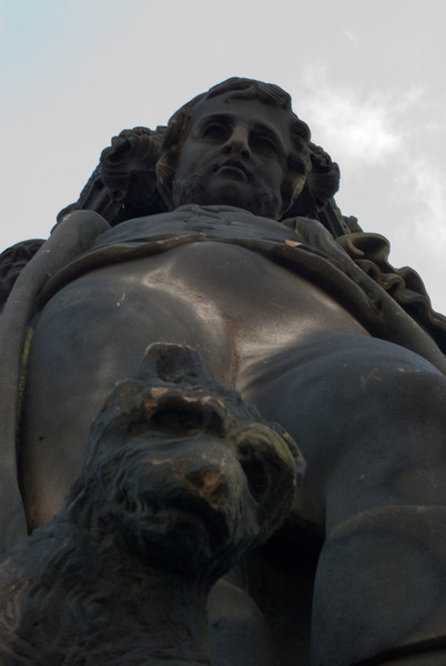 Looking up at the figures carved into the very top of the monument