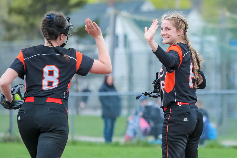 Skowhegan Picture Sydney Ames gives a high five to third baseman Mariah Whittemore who made the final out.
