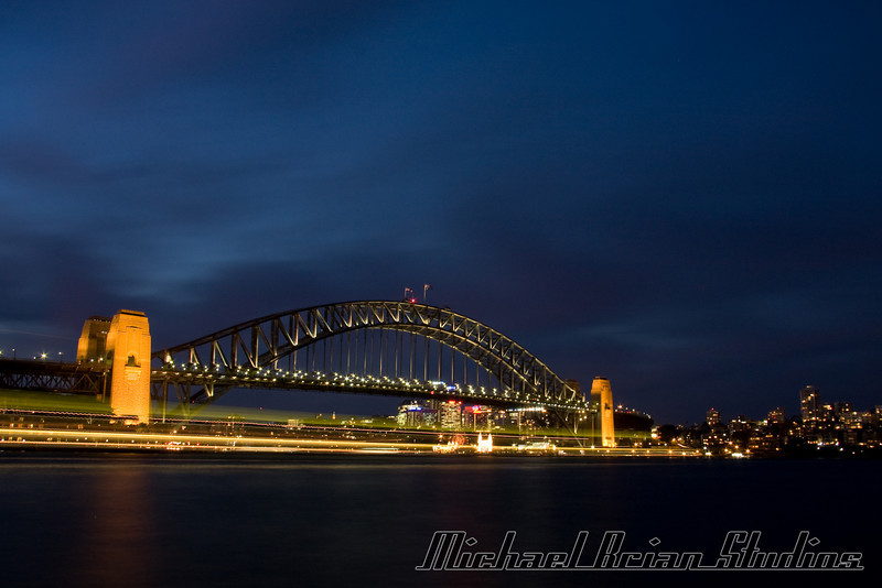 Sydney Harbor bridge at dusk.