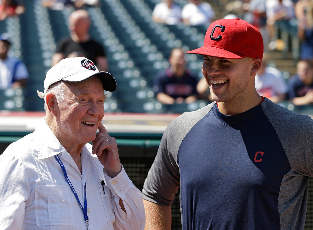 . Former astronaut and senator John Glenn, left, laughs with Cleveland Indians starting pitcher Justin Masterson before a baseball game against the New York Yankees Sunday, Aug. 26, 2012, in Cleveland. (AP Photo/Mark Duncan)