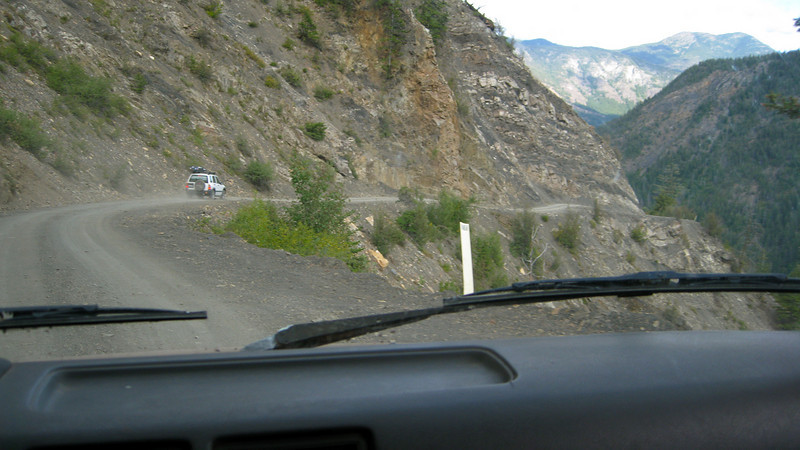 Driving the truck on steep one-laner Harts Pass road, the highest cliffiest road in the state:  Jenny (in the middle): I'm tightening my seatbelt.