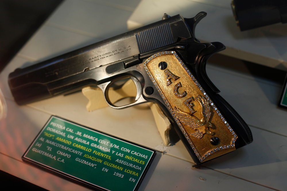 """. A gun, seized from drug lord Joaquin Guzman Loera, also known as \""""El Chapo Guzman\"""", is displayed at the drug museum, created to honor the fight against drug trafficking, at the Secretary of Defense headquarters in Mexico City, Wednesday, Aug. 18, 2010.  (AP Photo/Alexandre Meneghini)"""