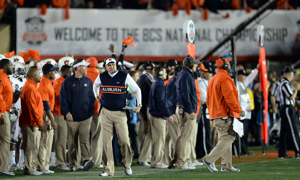 . Auburn head coach Gus Malzahn looks towards the score board as Florida State wins 34-31 during the BCS National Championship game at the Rose Bowl in Pasadena, Calif., on Monday, Jan. 6, 2014. Florida State won 34-31.