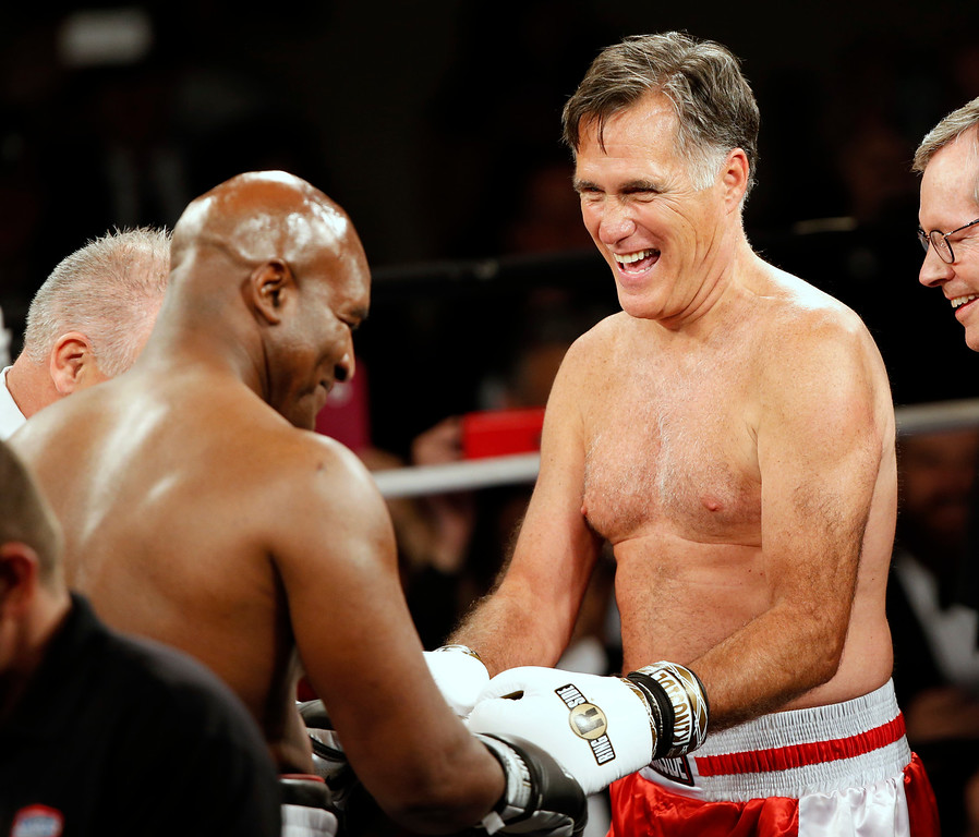 ". Mitt Romney and Evander Holyfield meet at center ring before a charity boxing event on May 15, 2015 in Salt Lake City, Utah.The event was held to raise money for  ""Charity Vision\"" a charity that aims to restore sight to the blind and visually impaired. (Photo by George Frey/Getty Images)"