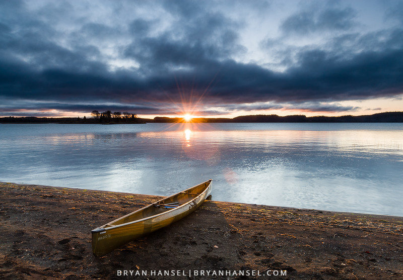 The sun breaks over the horizon on a brisk October morning. South Fowl Lake.g