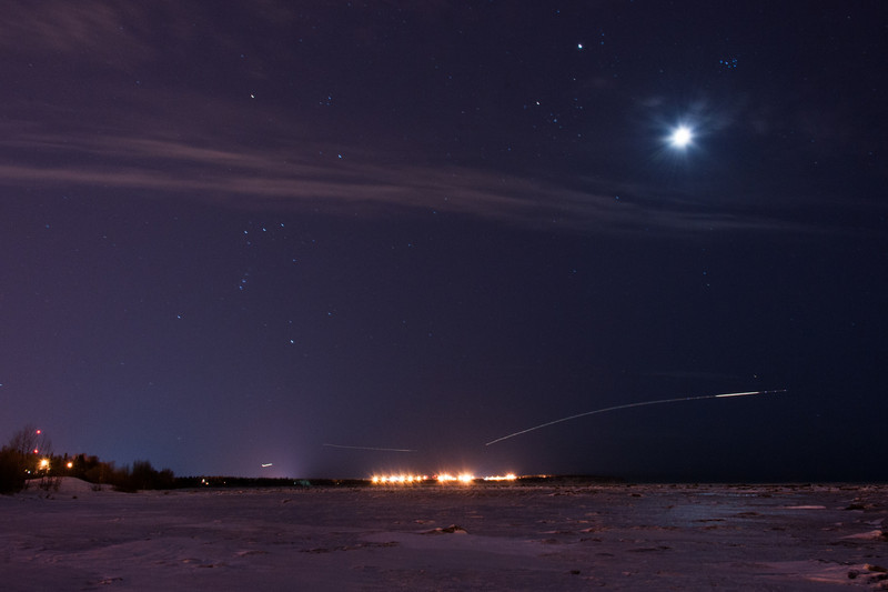 Orion, Moon, and Flights Over Anchorage