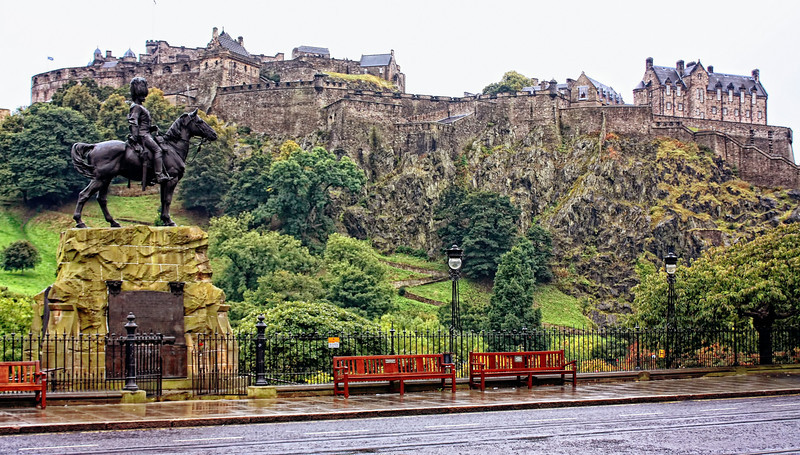 Edinburgh Castle On a rainy day in September.  A castle has been on this rock since the 12th century, and it was the royal seat until the merger with England in 1603.  The monument in front is to the soldiers who died in the Boer wars.
