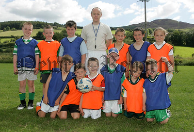 Pictured are under 10 age group participants of a coaching course organised by Camlough Rovers with their coach Paul Waters.