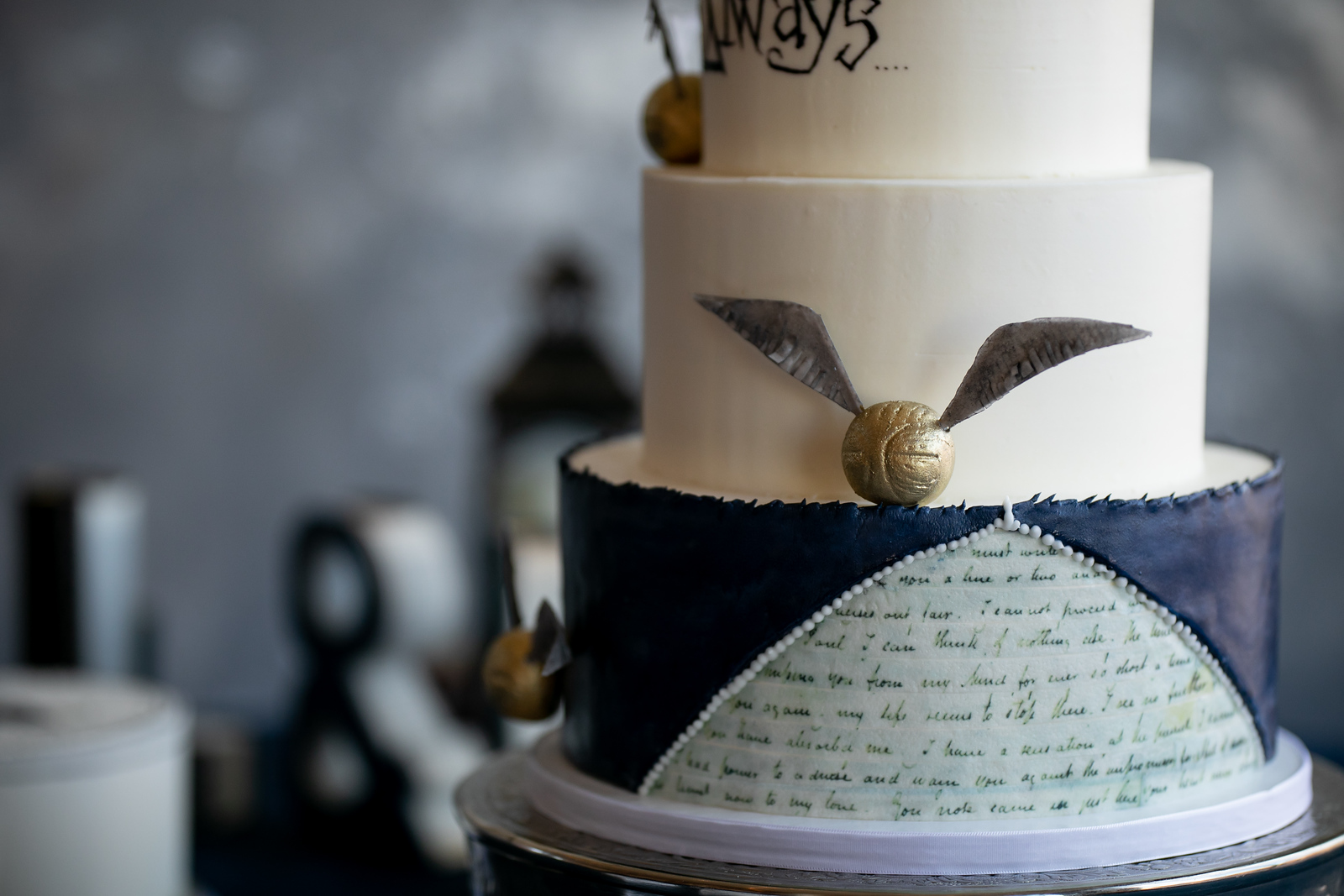 blue white and gold harry potter themed wedding cake