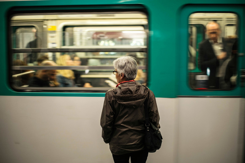 woman and speeding subway paris.jpg