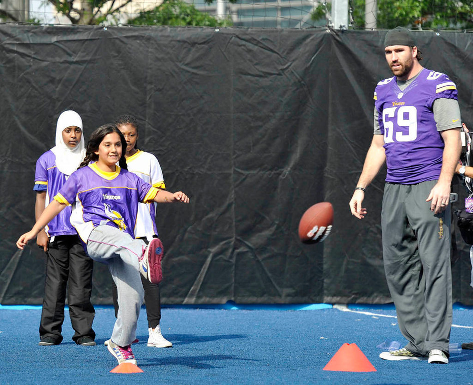 . Vikings defensive end Jared Allen watches a participant kick the football. (NFL: Sean Ryan)