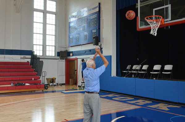 Coach Arritt christening the Court (pre-dedication) which were the first shots taken on the new court.
