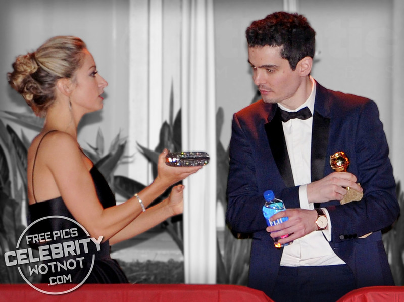 La La Land Director Damien Chazelle Tucks His Golden Globe Under His Arm With Girlfriend Olivia Hamilton